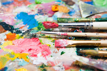 Mix of paints and paintbrushes close up