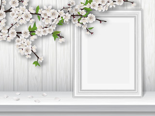 Spring blooming cherry branch and photo frame on a white table. Spring vintage interior decor. Vector greeting card template.