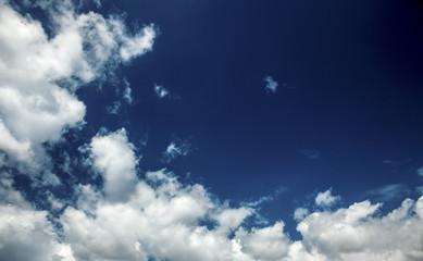 Clouds white on dark blue sky