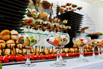 Buffet table of reception with burgers, cold snacks, meat and sa