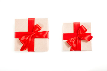 Gift box wrapped in recycled paper with red ribbon