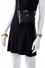 Retro leather purse on mannequin.