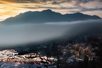 Beautiful morning sunrise with the mist shining on rice terrace in China.