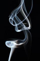 Movement of smoke on a black background.