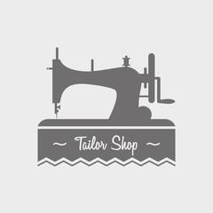 Tailor shop label, logo, emblem or designed element with sewing machine.