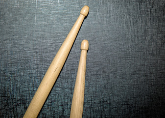 Wood Drumsticks in black texture background