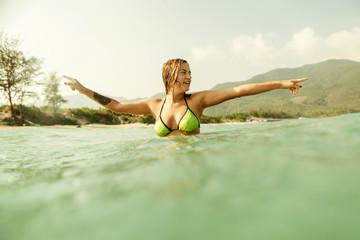 sexy bikini girl swim sea waves vintage tone