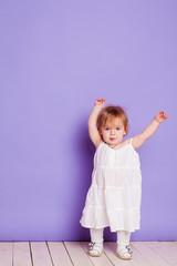 little girl in a white Sarafan