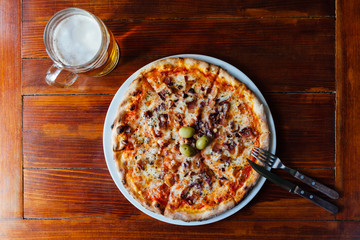 Delicious Pancetta Cipolla Pizza and Beer