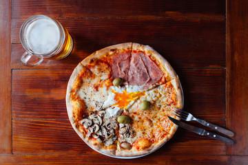 Delicious Quattro Stagioni Pizza and Beer