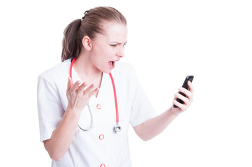 Angry mad doctor or medic woman yelling at phone