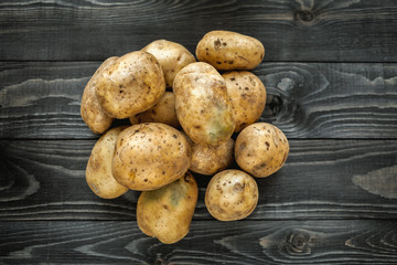 potatoes on wooden rustic background