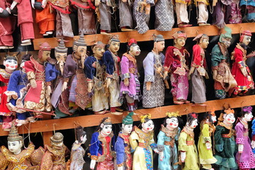 Colorful traditional puppets are sold as souvenirs on the street in Mandalay, Myanmar.