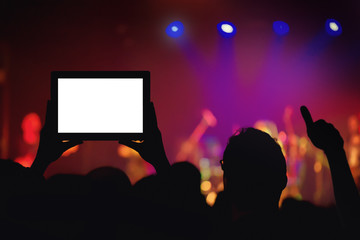 Rock concert crowd recording performance with digital tablet