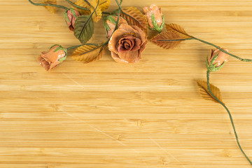 Fake flowers on the wooden floor
