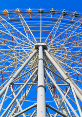 Steel structure of ferris with blue sky