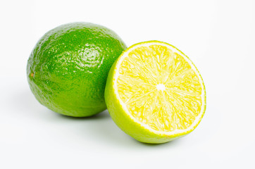 fresh lime wedge isolated on a white background