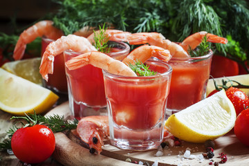 Seafood appetizer: shrimp with tomato sauce, herbs and spices, s