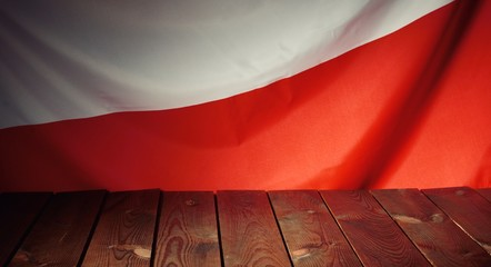 Flag of the Poland with wooden boards as a background.
