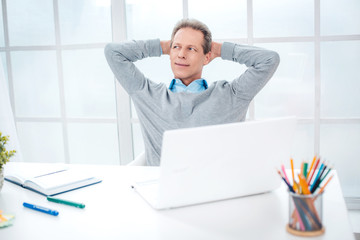 Adult businessman while working day