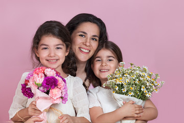 Girls giving flowers on Mothers day