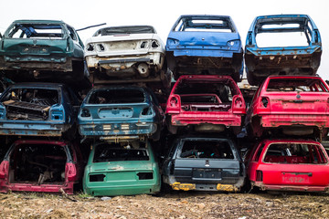 Car bodies stacked up at the junkyard