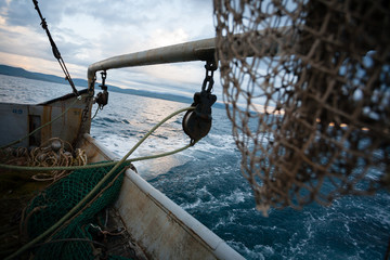 Fishing nets are on the deck of a small fishing vessel