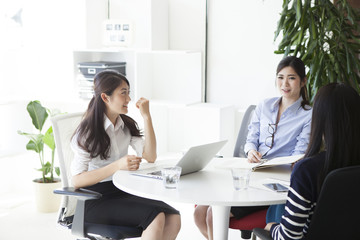 Business women have a meeting at the stylish office