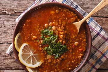 Arabic cuisine: Harira soup in a bowl close-up. horizontal top view