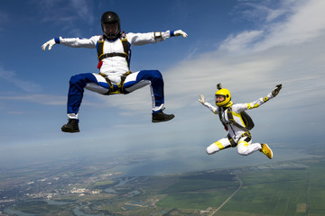 Girl and guy skydivers in freefall.