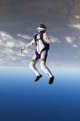 The girl parachutist performs figure freestyle in freefall.