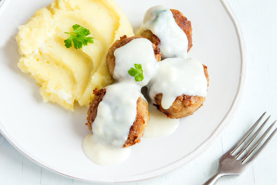 Meatballs with white creamy sauce