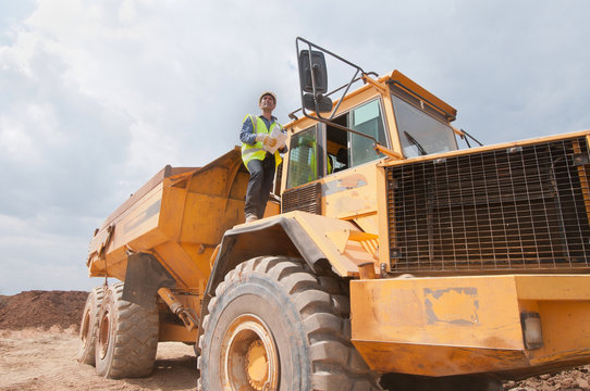 Engineer on dump truck in construction site