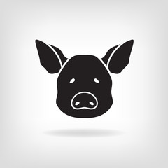 Stylized head of a pig on light background.