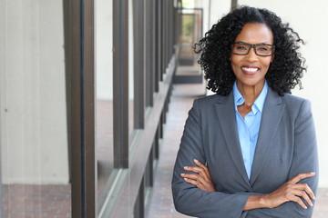 Closeup portrait, mature professional, beautiful confident woman wearing a power suit, friendly...
