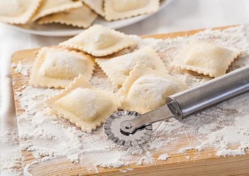 Making homemade Italian pasta ravioli with a cutting tool