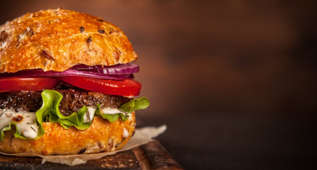 Fresh home-made hamburger served on wood