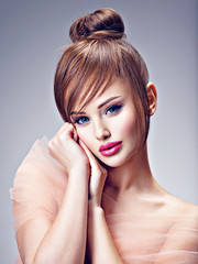 Beautiful redhead girl with style hairstyle.