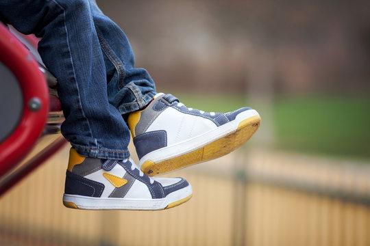 New sneakers on boys feet