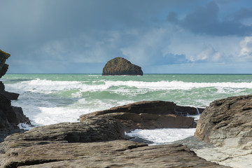 Wall Mural - Gull Rock with white waves breaking viewed from the beach Trebarwith Strand Cornwall England UK