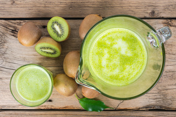 Fresh kiwi juice with mint on wooden background