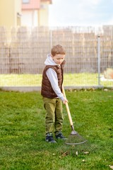 Small boy helping in the garden.