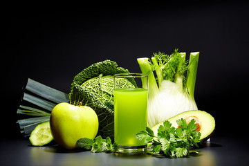 Fresh vegetable juices on black table