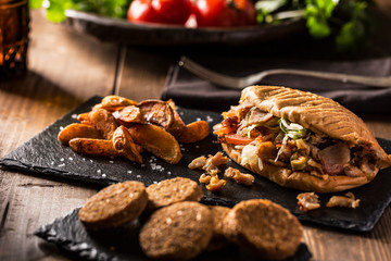 Doner kebab with fried potato on table