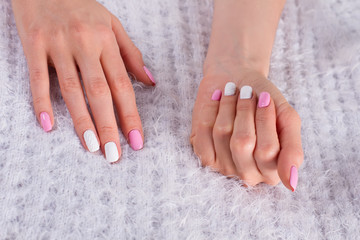 Fototapete - Female manicure on fluffy background.
