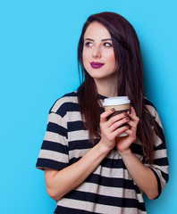 portrait of a young woman with cup of coffee