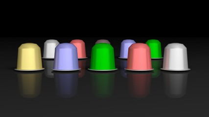 Colorful coffee capsules, isolated on black background.