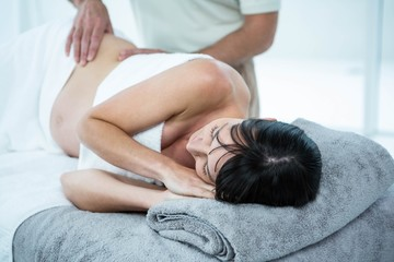 Pregnant woman receiving a back massage from masseur
