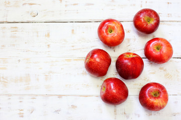 delicious fresh apples on white wood background
