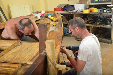 Workers in a Boat Carpentry Workshop